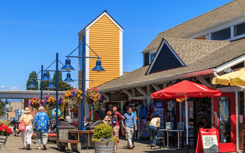 Richmond, BC, - July 08, 2014: Unidentified people enjoying sunny day in Steveston Village in Richmond, BC on July 08, 2014. Steveston is a historic fishing village. It has become a popular place to visit and live.